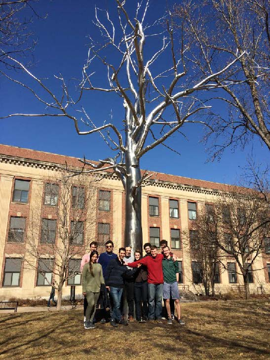 Students standing around the famous metal tree on the University of Nebraska-Lincoln campus