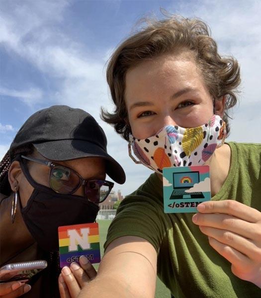 oSTEM members show off their cute new oSTEM @ Nebraska stickers at the club fair (Fall, 2020)