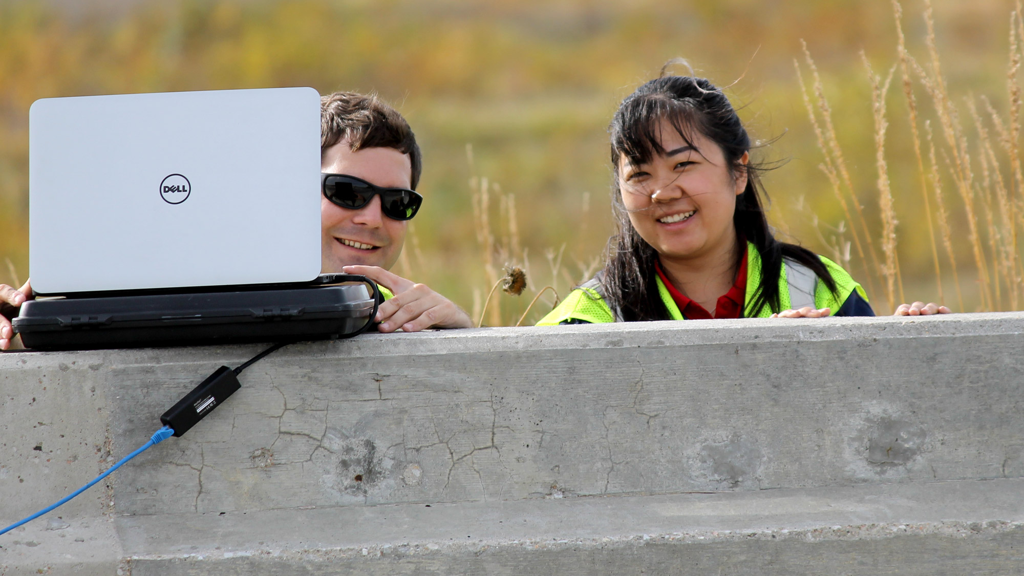 Professor and student working in field, links to Prospective Students page