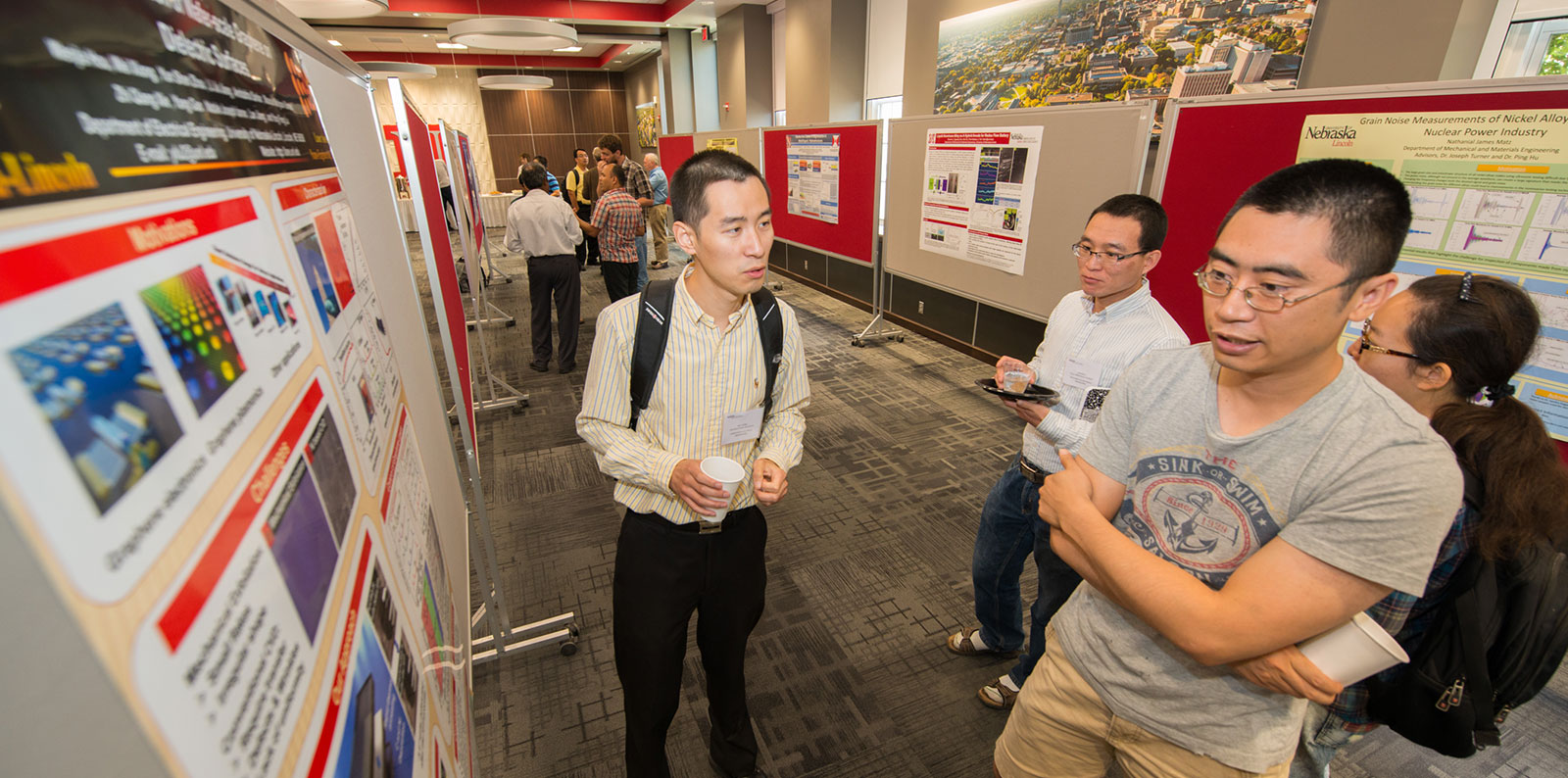 Dr. Wei Xiong discusses a poster display