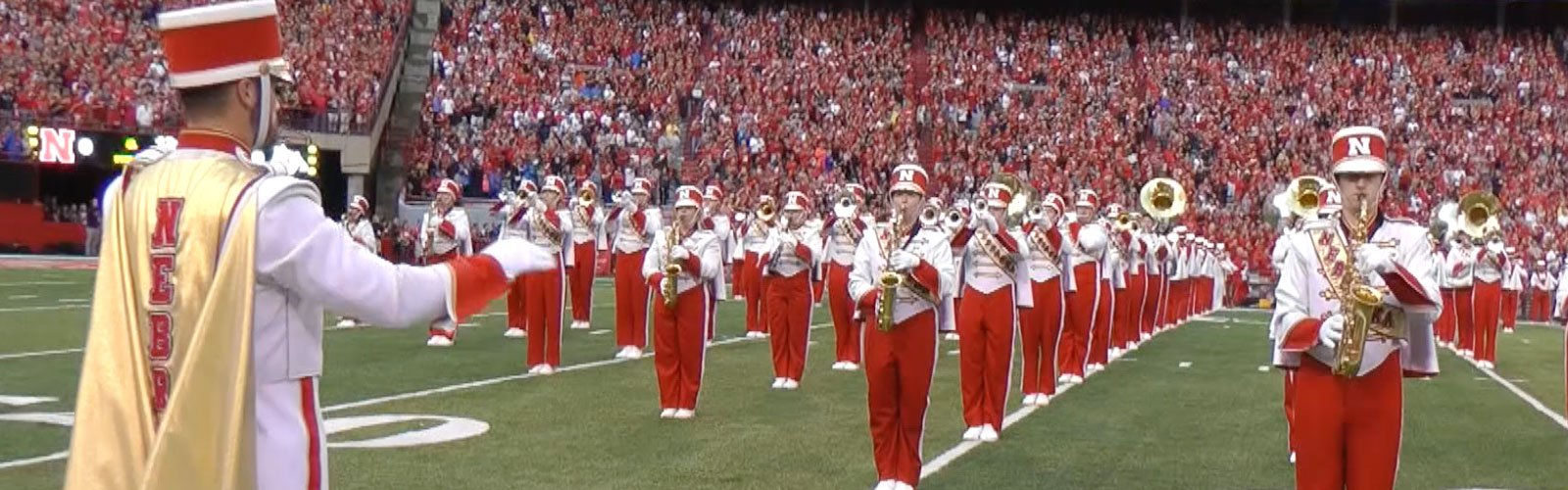 Husker Marching Band on the Field with Civil Engineering Major Austin Moran leading them.