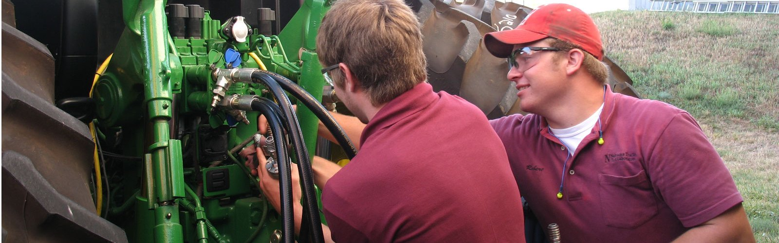 Students working on a tractor
