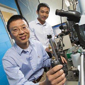 Ming Han (left) and Giugen Liu. (Photo by Craig Chandler / University Communications)