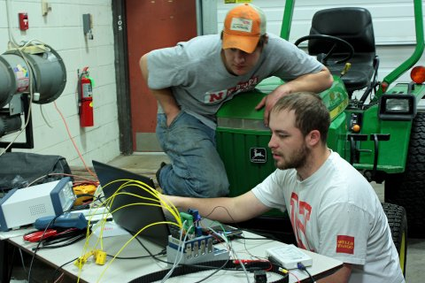 Members of the Quarter-Scale Tractor Team use the latest Computer Aided Design technology to design their award winning tractors.