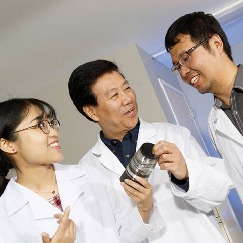 Nebraska researchers (from left) Wei Li, Yiqi Yang and Bingnan Mu have collaborated with colleagues in China to develop a more robust, biodegradable plastic fiber derived from corn starch. (Photo by Craig Chandler/University Communication)