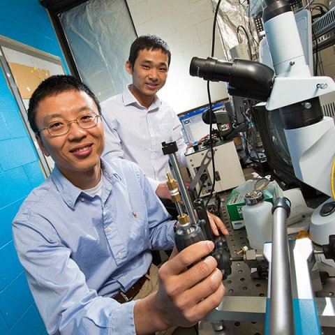 Ming Han (left), associate professor of electrical and computer engineering, and Guigen Liu, a postdoctoral researcher in electrical and computer engineering,