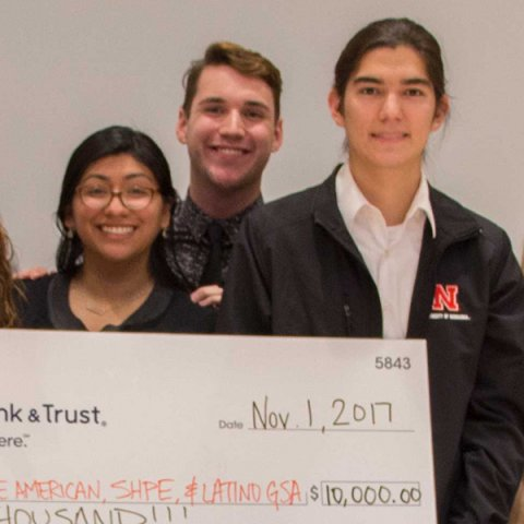 The university chapter of Society of Hispanic Professional Engineers (SHPE) and its president Francisco Garcia (right) were part of a coalition of three RSOs that produced the winning presentation at the Nov. 1 Pitch A Program event.
