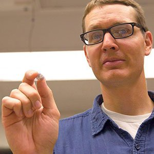 Benjamin Terry, assistant professor of mechanical and materials engineering, holds a prototype of his team's tapeworm-inspired attachment mechanism. The device adhered to the wall of a live intestine for six days.