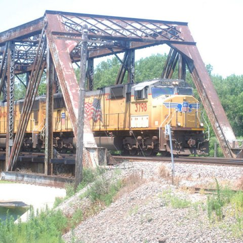 A Union Pacific Railroad train crosses the Loup River just west of Columbus. This bridge is part of a pilot project undertaken by Union Pacific and the Department of Civil Engineering at the University of Nebraska-Lincoln. (Photo by Columbus Telegram)