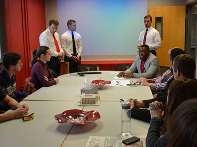 J.K. Osiri, director of UNL's international business program and associate professor of practice in management, meets with engineering and business students to discuss the team's project to help the Kinawataka Women Initiatives in Kampala, Uganda.