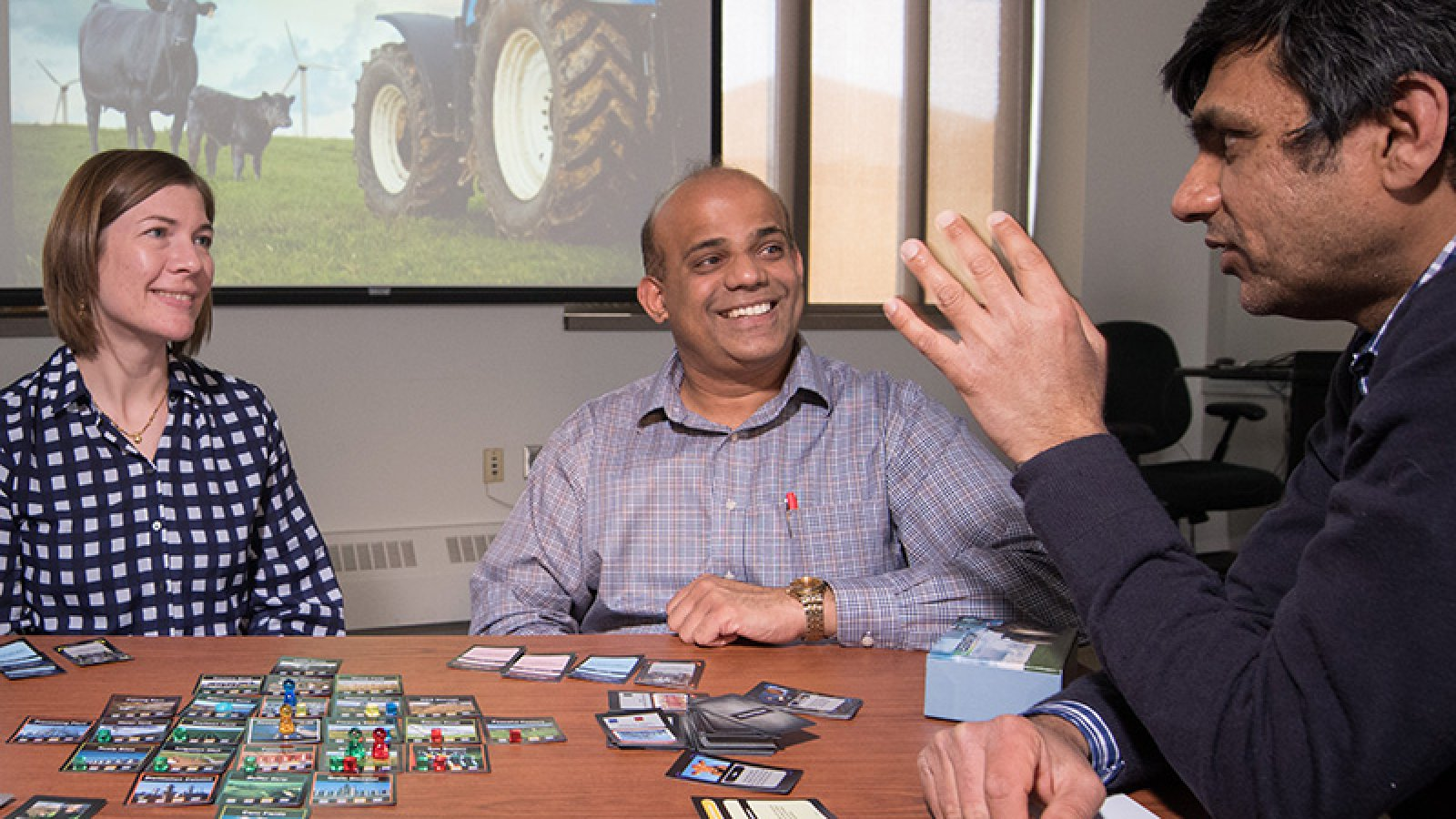 Biological Systems Engineering faculty (from left) Jenny Keshwani, Jeyam Subbiah and Ashu Guru have developed AgPocalypse, a video game to teach farming.