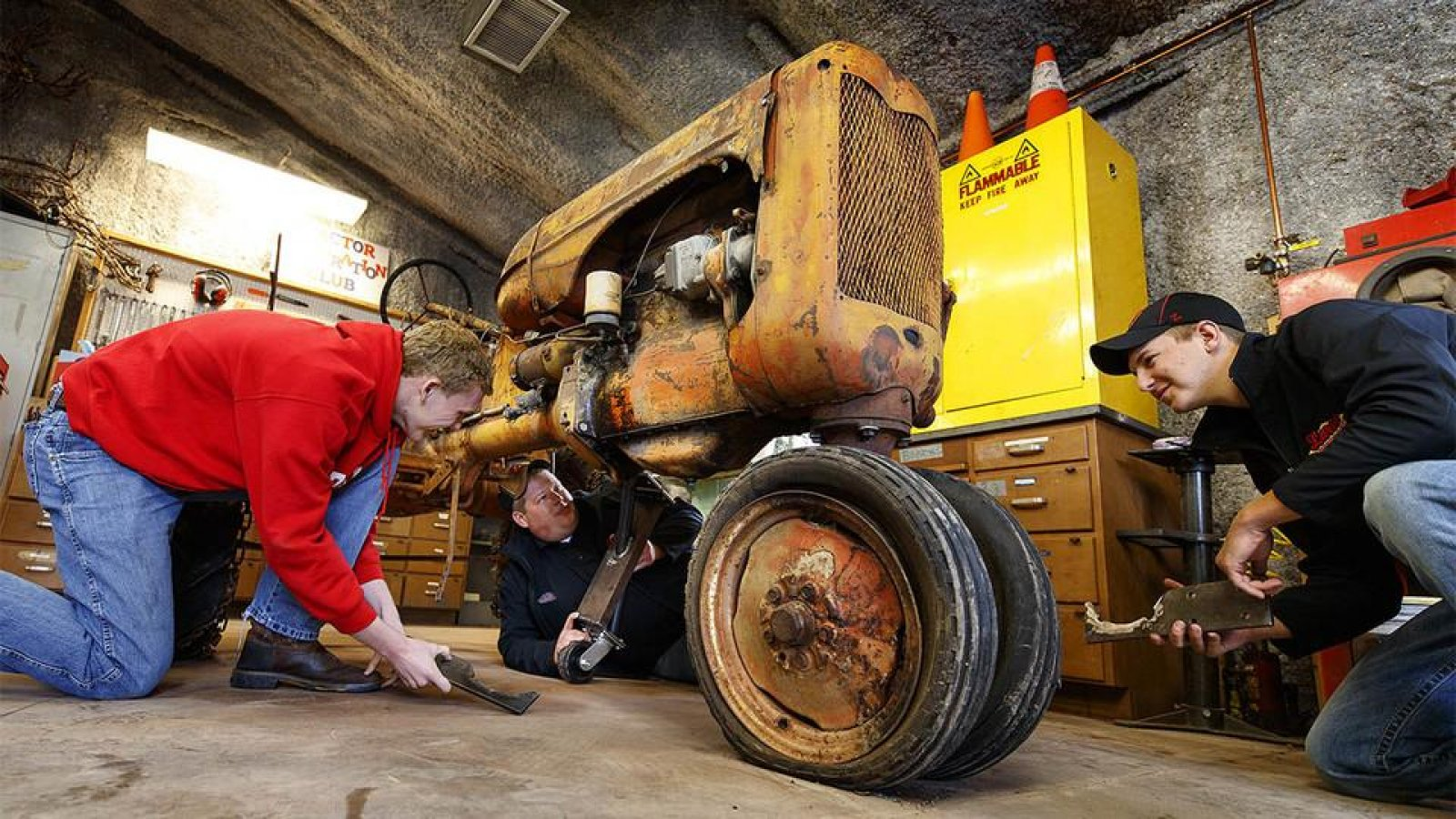 Tractor Restoration Club members work to prepare a 1945 Allis Chalmers Model C for display at the Homestead National Monument near Beatrice. (Photo by Craig Chandler / University Communication)