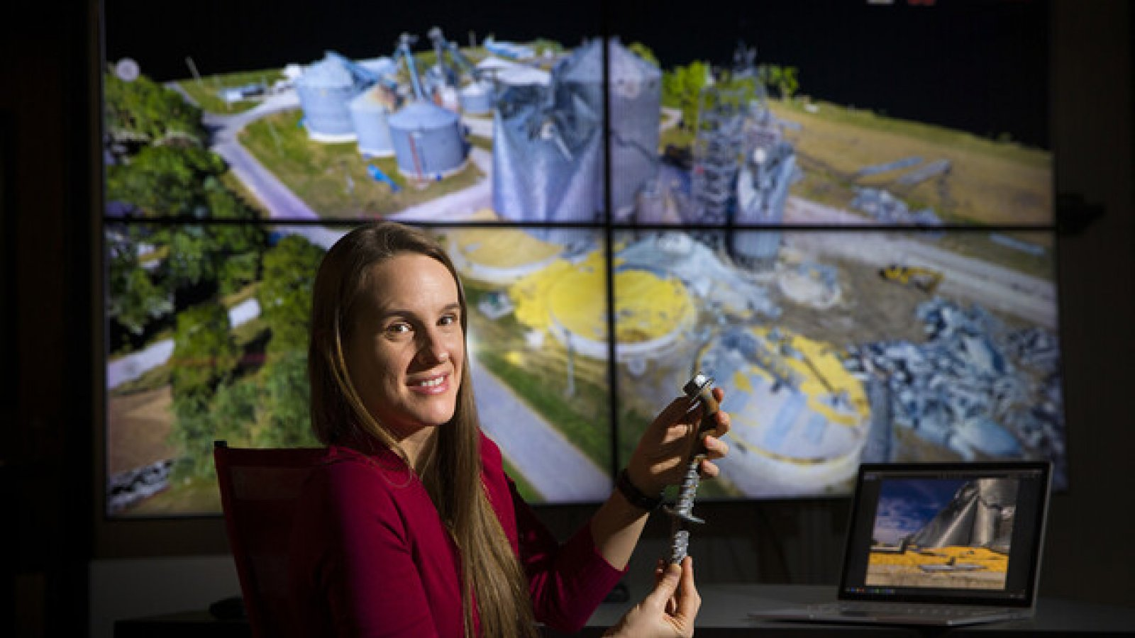 Christine Wittich compares a damaged anchor from the field with three-dimensional point cloud data of the structure. Wittich is an assistant professor of civil and environmental engineering. (University Communication photo)