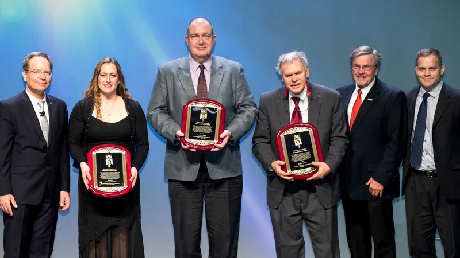 Members of SAE International present the John Melvin Motorsports Safety Award to Karla Lechtenberg, Ron Faller and Dean Sicking