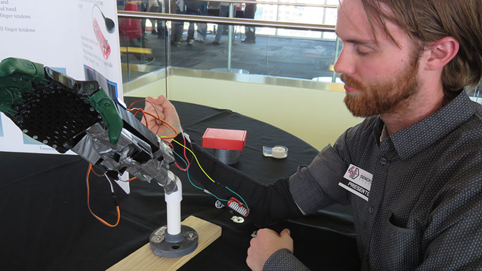 Student working with a device for the Senior Design Showcase