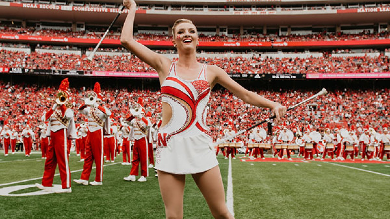 Kimberly Law, a freshman in chemical engineering from La Quinta, California, is one of two featured twirlers in the Cornhusker Marching Band. (Photo by Justin Mohling)