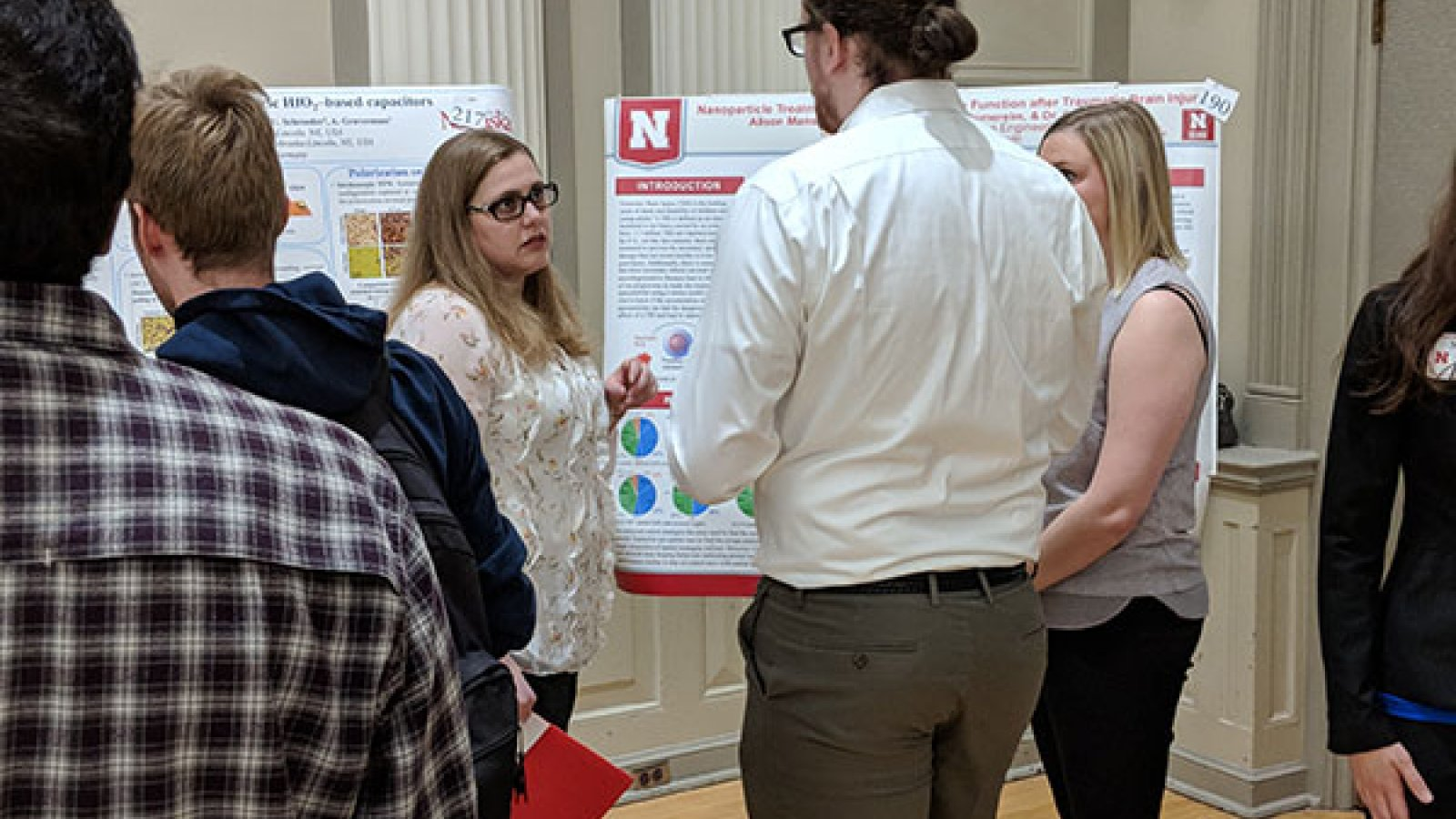 Connor Gee (center) and Allison Manske (right), biological systems engineering students, discuss their project with Nicole Iverson, assistant professor of biological systems engineering.