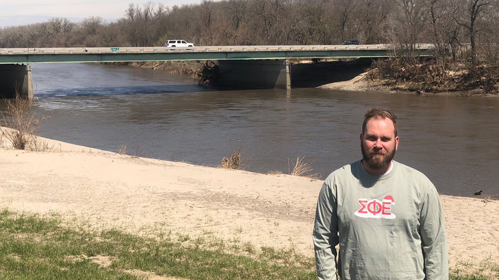 Kyle Rotert, a senior in architectural engineering, stands on the levee near the Maple Street bridge in Waterloo. In March, the Elkhorn River surged more than 5 feet above flood stage. Rotert said he learned plenty about engineering by helping to monitor the levees during those hectic days.