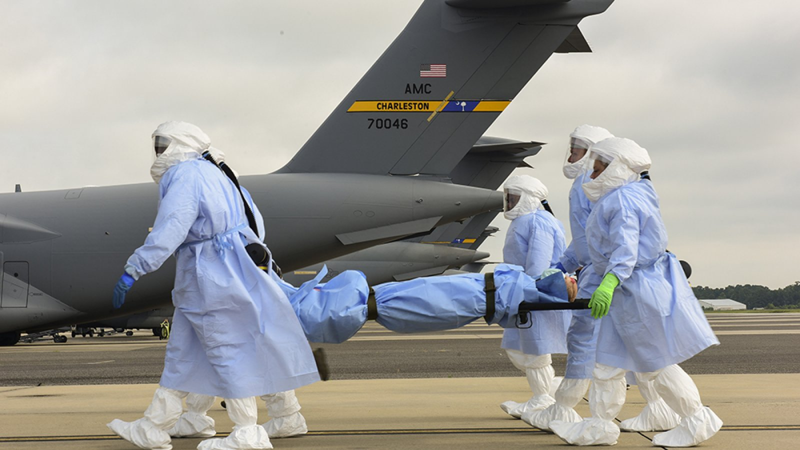 U.S. Air Force personnel carry a dummy on a stretcher during a 2018 simulated mission in which Durham School faculty Kelli Herstein and Terry Stentz studied the performance of personnel and equipment in missions to retrieve people exposed to infectious diseases.