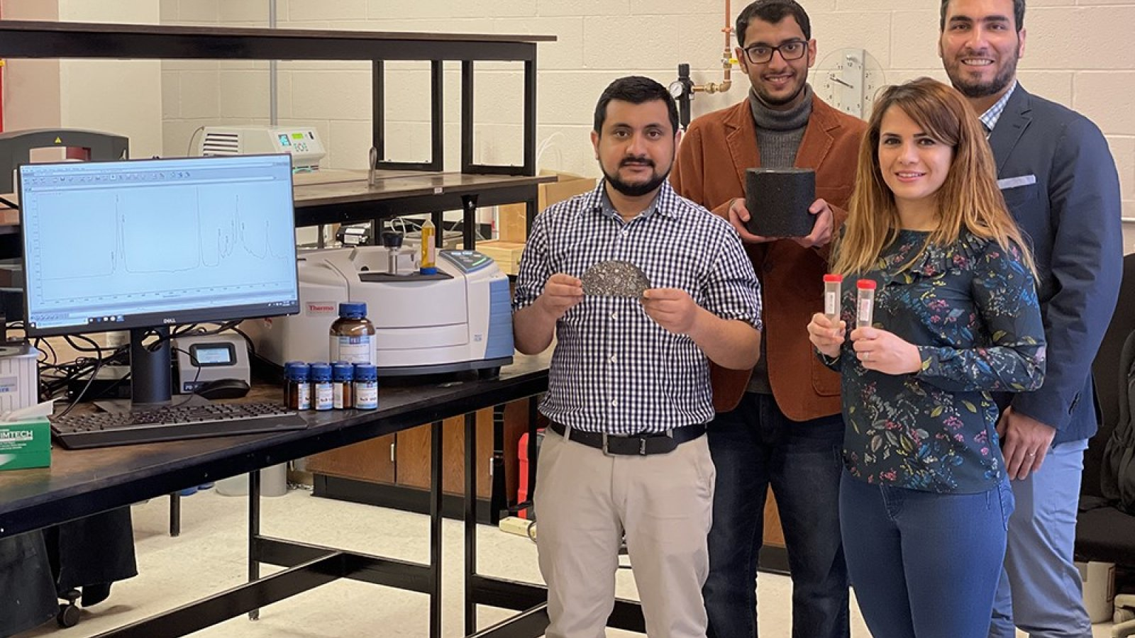 The team of Husker researchers and engineers working on the asphalt project includes (from left) Nitish Bastola, Khalid Al Washahi, Mahdieh Khedmati and Hamzeh Haghshenas Fatmehsari.