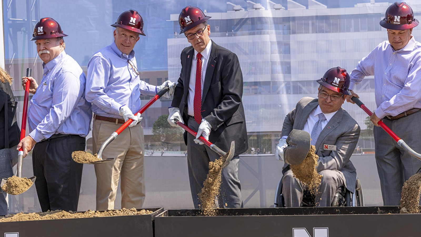 Dean Lance C. Pérez (second from right) joins with members of the College of Engineering Advisory Board and the UNL Chancellor in turning a shovelful of dirt during the groundbreaking ceremony for Kiewit Hall on Monday, June 28. (Craig Chandler / University Communication)