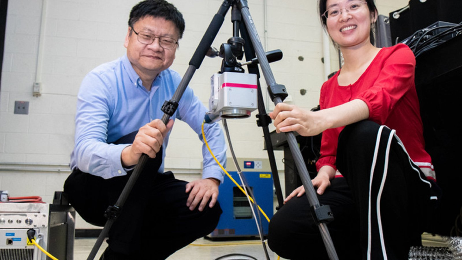 Yongfeng Lu (left) and doctoral student Lei Liu with a portable laser that helps prevent and repair corrosion on aluminum-sided ships. (Photo by NUtech Ventures)
